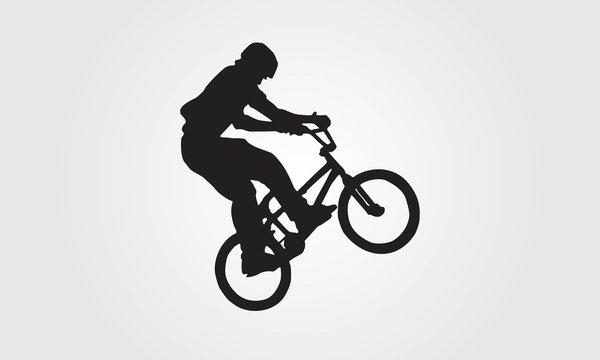 Cyclist rider bmx performs trick jump logo silhouette vector