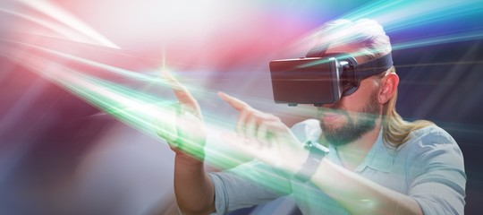 Composite image of man pointing while wearing virtual reality