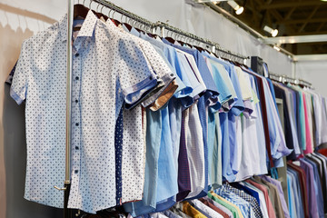 Men's shirts in clothing store