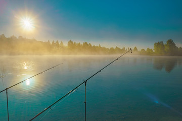 Fishing on a forest lake at sunset