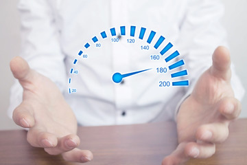 Man holding car speedometer. Speed concept.