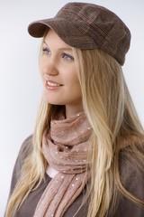 Woman in cap looking away