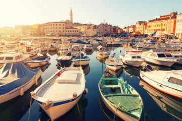 Sunset at medieval town of Rovinj, colorful with houses and church,harbor Wall mural