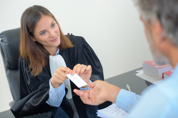 a businesswoman signing a contract