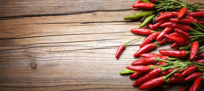 Red chili pepper on wooden background