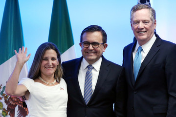 Canadian Foreign Minister Chrystia Freeland, Mexico's Economy Minister Ildefonso Guajardo and U.S. Trade Representative Robert Lighthizer smile as they pose for a photo in Mexico City