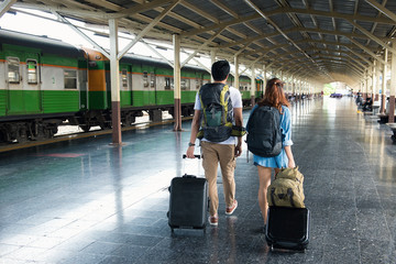 Couple traveler, Asian tourist with luggage walk at train in station