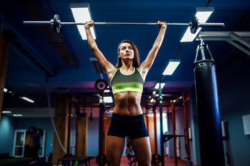 Young fitness woman lifting a weight crossfit in the gym. Fitness woman deadlift barbell. Crossfit woman. Crossfit style. Crossfit and fitness