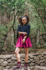 Stylish girl posing in forest