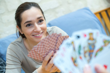portrait of smiling girl playing cards