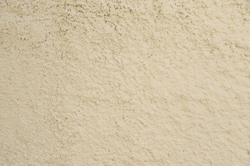 Old beige painted wall background texture