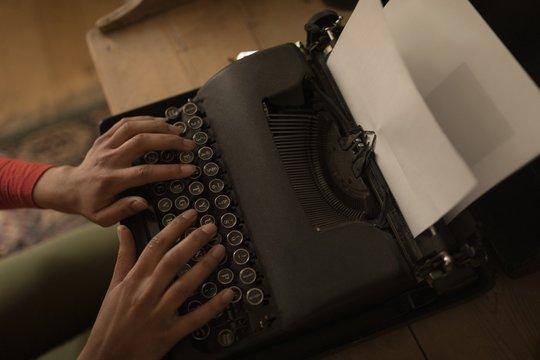 Woman working on typewriter at home