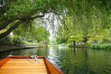 Punted along the River Avon in Christchurch New Zealand, under the green trees