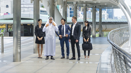 global business people smart man and woman walk and talk business negotiations in feeling success and happy with the city space background in the outdoor