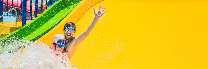 Tuinposter Amusementspark BANNER Father and son on a water slide in the water park Long Format