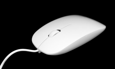 white mouse for the computer on a black background