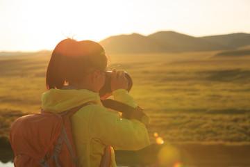 Photographer taking photo in beautiful landscape