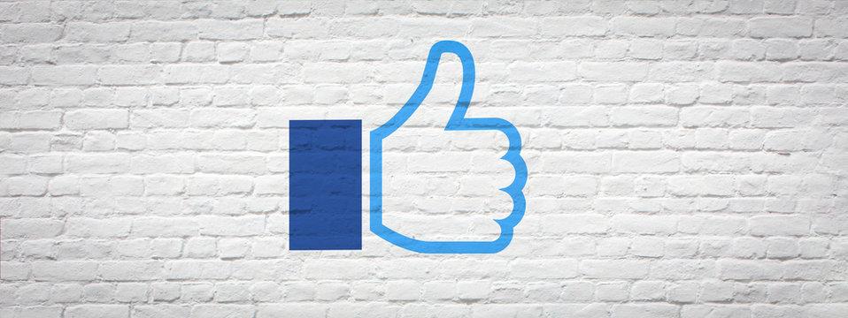 Thumbs up on a brick wall
