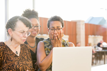 Closeup portrait, multigenerational family looking at something horrible on laptop, isolated outdoors background