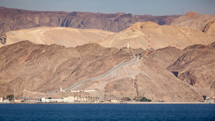 Coastline landscape of the boarder between Egypt and Israel on the Red Sea in the Gulf of Aqaba. The fence is the boarderline. / Egypt and Israel Coastal Landscape