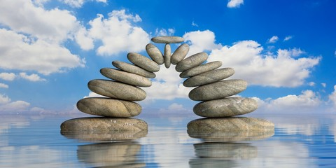 Zen stones on blue sea and sky background. 3d illustration
