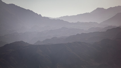 Mountain landscape silhouette of the hills in Jordan along the coastline of the Red Sea / Mountain Landscape Silhouette