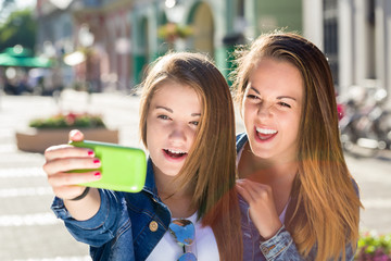 two teen girl taking selfie photo