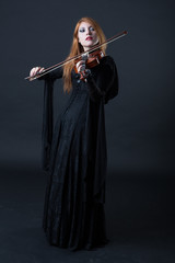 Medieval redhead violin player