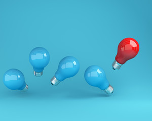 Outstanding light bulbs red in air one different idea from the others on  blue background, Minimal concept idea.