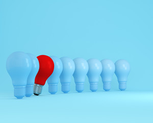 Row of light bulbs red one different idea from the others on light blue background, Minimal concept idea.