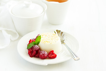 Delicious home-made dessert Panna cotta. Cream-caramel, caramel custard, with raspberries.