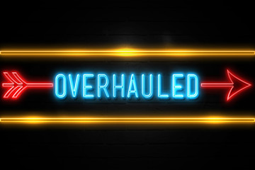 Overhauled  - fluorescent Neon Sign on brickwall Front view