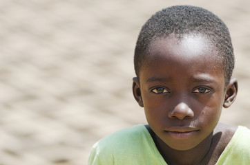Close-up Portrait of African black Boy outdoors as a Child Labour Concept - Working Children