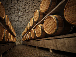 Stocked wine barrels across two sides of corridorof a wine cellar