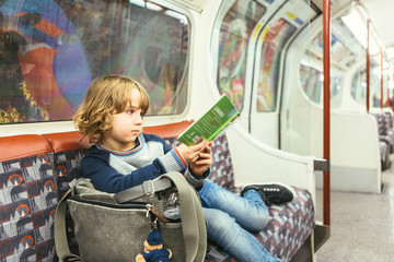 Young boy traveling by subway