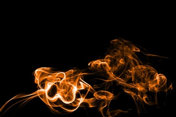Abstract color smoke on black background, orange smoke background,orangeink background,orange smoke, beautiful color smoke