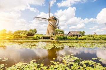 Landscape view on the old windmills during the sunny weather in Kinderdijk village, Netherlands