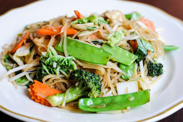 Veggie Noodle, Stir-fried thin rice noodles, bean sprouts, broccoli, carrots, baby corn, peapods, napa and sweet basil leaves.