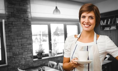 Composite image of smiling waitress holding a cup of coffee