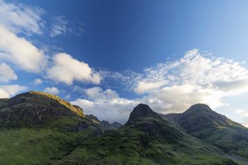 The three sisters Beinn Fhada, Gearr Aonach, and Aonach Dubh as seen from Glen Coe in Scotland.