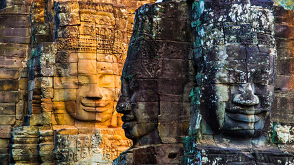 Stone murals and statue Bayon Temple Angkor Thom. Angkor Wat the largest religious monument in the world. Ancient Khmer architecture.  Location: Siem Reap, Cambodia.