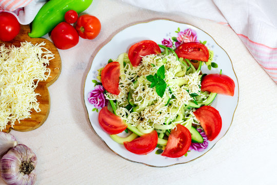 Homemade Zucchini Noodles Zoodles Pasta with Tomatos and Feta on white wooden background