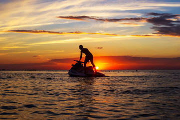Recess Fitting Water Motor sports silhouette of a man on a jet ski in the sun