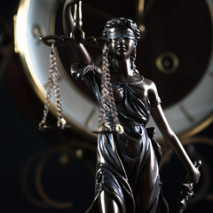 Law and Justice symbols on dark background