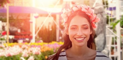 Composite image of beautiful smiling woman with a flower crown