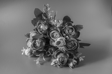 Flowers are on a black and white background.