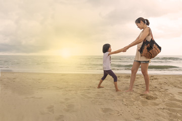 mother and child relationship play beach front sea