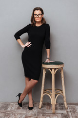 Full length image of beauty business woman in eyeglasses