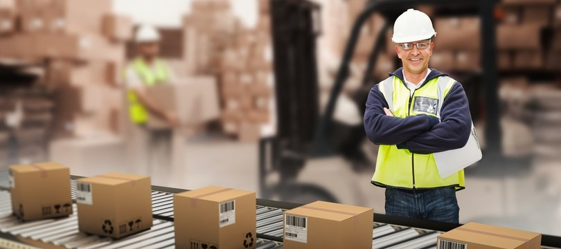 Composite image of worker wearing hard hat in warehouse