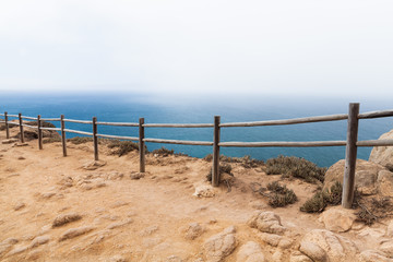 Old wooden railings on the edge of Cabo da Roca
